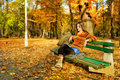 Woman in Autumnal park Royalty Free Stock Photos