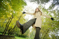 Woman in autumnal park Stock Images