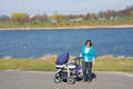Woman with baby buggy Royalty Free Stock Photo