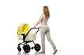 The woman with baby and pram on white isolated Royalty Free Stock Images