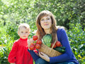 Woman and baby with vegetables harvest Royalty Free Stock Photo
