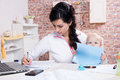 Woman with baby working from home young Royalty Free Stock Photos