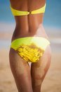 Woman back and ass yellow swimsuit Royalty Free Stock Photo
