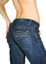 Woman back is pose in blue jeans Stock Photos