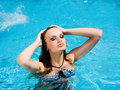 Woman with the background of a pool behind Royalty Free Stock Image