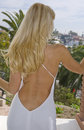 Woman in Backless Dress from behind Stock Images