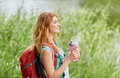 Woman with backpack and bottle of water hiking Royalty Free Stock Photo
