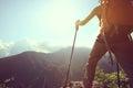 Woman backpacker enjoy the view on mountain peak Royalty Free Stock Photo