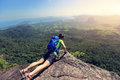 Woman backpacker enjoy the view on mountain peak Royalty Free Stock Photo