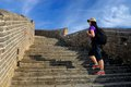 Woman backpacker on the great wall of china Stock Photos