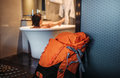 Woman backpacker traveler take a bath in high quality hotel Royalty Free Stock Photo