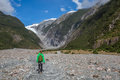 Woman backpacker walking in franz josef glacier new zealand Stock Photography