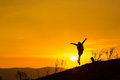 Woman backpacking to watch the sunset.Silhouette,Jumping glad Royalty Free Stock Photo