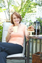 Woman in backyard with coffee and cookies Stock Photos