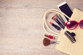 Woman bag with makeup and fashion objects. View from above Royalty Free Stock Photo