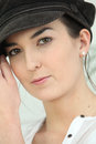 Woman in a baker boy cap closeup of young Royalty Free Stock Images