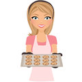 Woman baking chocolate chip cookies