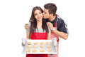 Woman baking cookies with her boyfriend isolated on white background Royalty Free Stock Image