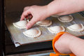 Woman baking pastry at home housewife in kitchen oven Stock Images