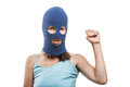 Woman in balaclava showingraised fist gesture Stock Photography