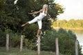 Woman balancing on fence post Royalty Free Stock Photo