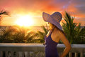 A woman on a balcony looking at the beautiful caribbean sunset Royalty Free Stock Images