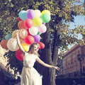 Woman with balloons happy young colorful latex outdoor Royalty Free Stock Photos