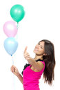 Woman with balloons smiling and showing thumb up Stock Images