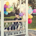 Woman with balloons young colorful latex outdoor Royalty Free Stock Photo