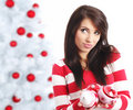 Woman with balls next to christmas tree Royalty Free Stock Images