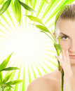 Woman with bamboo plant Royalty Free Stock Photo