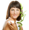 Woman with bamboo spa young Royalty Free Stock Photography