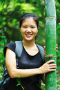 Woman with bamboo tree Royalty Free Stock Image