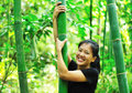 Woman and bamboo tree Royalty Free Stock Image