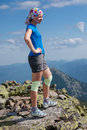 Woman bandage knees stands stone outdoor Royalty Free Stock Images