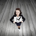 Woman with banner top view of businesswoman holding white red tick Stock Images