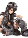 Woman in barbarian costume beautiful at white background Royalty Free Stock Photo