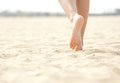 Woman barefoot walking on beach close up low angle Royalty Free Stock Photos