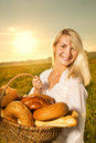 Woman with a basket of bread Royalty Free Stock Images