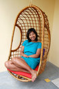Woman in Basket Chair Stock Image