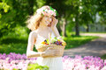 Woman with a basket of fruit in hand cute young Stock Photos