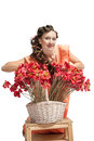 Woman with basket full of flowers attractive Royalty Free Stock Image