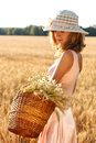 Woman with basket full of ripe ears wheat Royalty Free Stock Photos