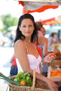 Woman with a basket of market produce Royalty Free Stock Image
