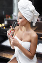 Woman after bath drinking champagne in hotel bathroom Royalty Free Stock Photography