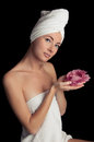 Woman after bath with towel and flower Royalty Free Stock Photos