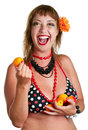 Woman in bathing suit with apricots smiling young her hands isolated on white Royalty Free Stock Photos