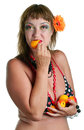Woman in bathing suit eating apricots the young isolated on white Royalty Free Stock Photo