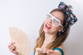 Woman in bathing suit holding hand fan Royalty Free Stock Photo
