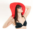 Woman bathing suit red hat white background Stock Photography